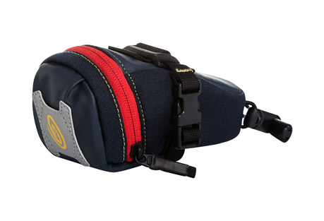 timbuk2 bike seat pack xt - medium- Save 50% Off - New and reinvigorated, the Timbuk2 Seat Pack has been revolutionized. The result is the Seat Pack XT. The XT has Timbuk2's signature wide-mouth opening for quick and easy access, blinky light attachment and reflective hits for safe night riding, plus waterproof accents and a new attachment system. The bungee seat post attachment is a synch to use and the accompanying SR buckle makes it easy to attach to rails and adjust until you're comfy. You'll want to ride it everywhere.  Features:  - Wide mouth opening allows quick access  - Bungee and keeper attachment fit multiple sized seat posts  - Easy and secure on-off bike attachment - adjustable SR buckles attach to rails in multiple positions  - In-pocket key keeper  - Reflective hits  - Alternate images may show different colorways, yet accurately display product features  Dimensions:  - Size: Medium  - Top Width: 8.3 in / 21 cm  - Bottom Width: 6.7 in / 17 cm  - Height: 3.9 in / 10 cm  - Depth: 2.8 in / 7 cm  - Weight: 0.2 lbs / 0.1 kg  - Volume: 31 cu in / 0.5 L